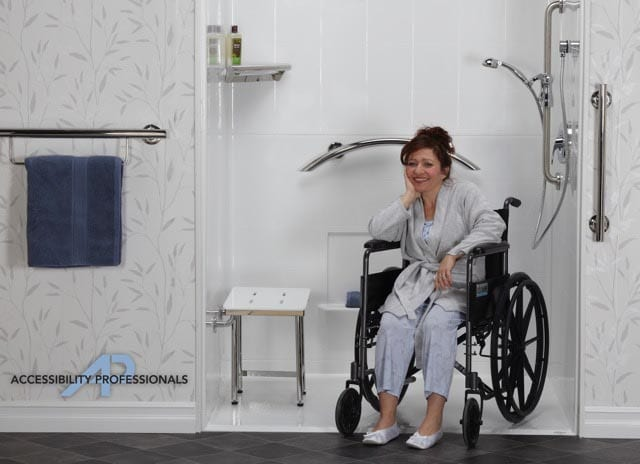 freedom accessible shower with woman in wheelchair