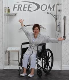 woman in wheelchair in front of accessible shower